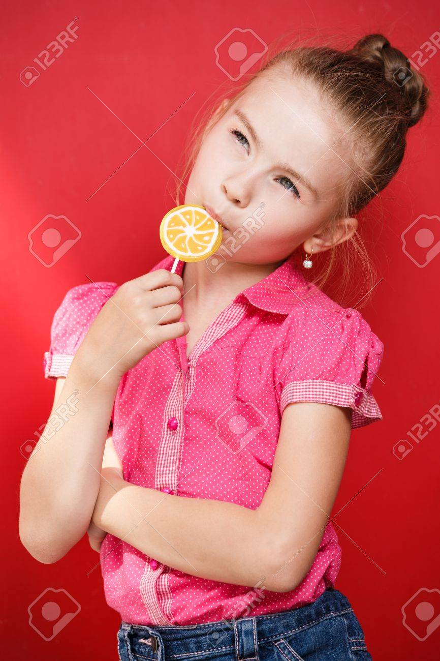 Very young girl eating candy